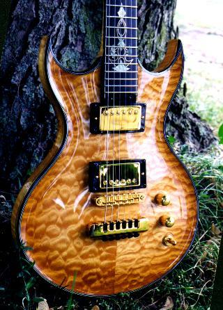 Carved top quilted maple